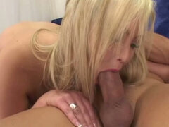 Thick blonde woman with massive tits sucks...
