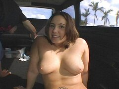 A curvy tattooed hussy gets a good hard dicking in the back of her buddy's van