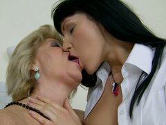 Mutual Interest Makes Brunette School Girl Have Lesbian Sex with Granny