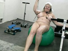 Busty blonde granny works on her fat body at the GYM