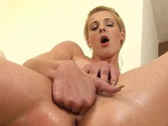 Blonde is inserting her hand in her pussy