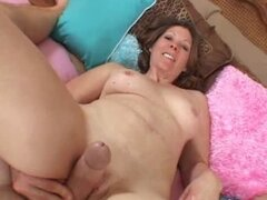 MILF Rubbing Her Twat Against A Cock