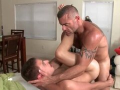 Muscled gay masseur trying his clients tight ass hole