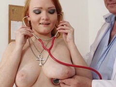 Milf redhead in medical fetish video