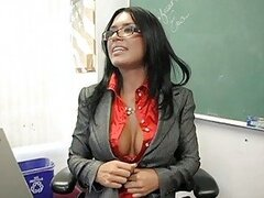 Hot busty teacher with glasses masturbates in the classroom