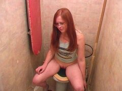 Redhead nerd goes piss on camera