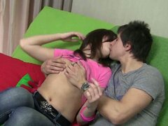 Sweet young teen couple nasty smooching session on couch