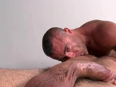 Gay masseur giving blowjob and rim job on his work table