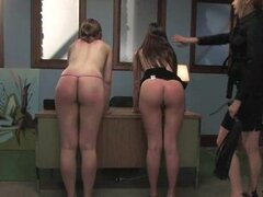Hot dominatrix action with two young bitches getting whipped
