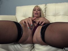 Thick blonde babe in stockings shoves a dildo deep into her pussy
