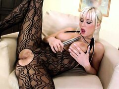 She�s wearing a full-body stocking and using a really long dildo