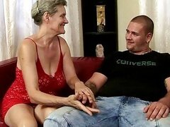 Busty grandma riding young cock
