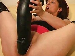 Crazy amateur milf fucks a gigantic monster dildo