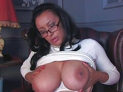 Arousing dark haired milf wth glasses and huge boobs masturbating